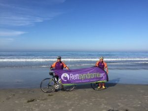 bikers holding a rett syndrome sign