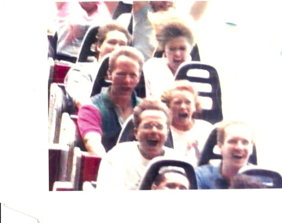 Letice Jolley on a rollercoaster with her father