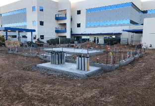 Installing new concrete pads for the Utility Transformer, Generator, Transfer Switch and Service Entrance.