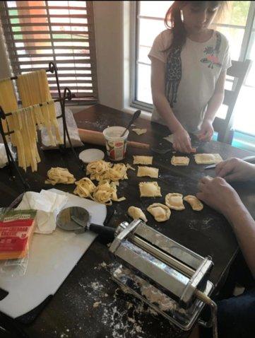 Jaeleen enjoying Family Fun Month by cooking